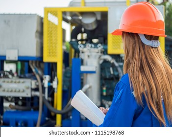 Engineer woman in industry factory checking production.