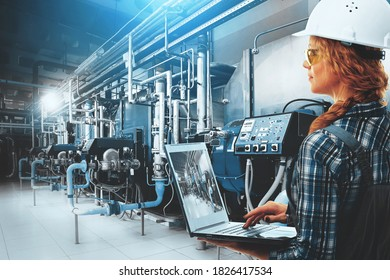 Engineer woman with laptop inspect modern industrial gas boiler room. Heating gas boilers, pipelines, valves. Blue toning with sunflare. Mixed media