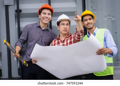 Engineer and worker checking plan or blueprints on construction site.  Construction Concept