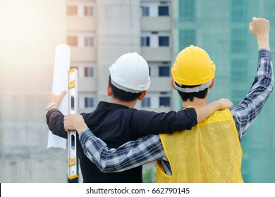 Engineer and worker hand up in front of the building, Engineering successful concept