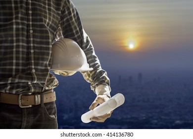 Blueprint paper stock photos images photography shutterstock engineer or worker holding in hand helmet for workers security and blueprint paper plan on cityscape malvernweather Choice Image