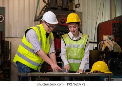 Engineer and worker industry factory wear safety uniform ,helmet working and discussion detail about plan of work, machine work control machine in factory