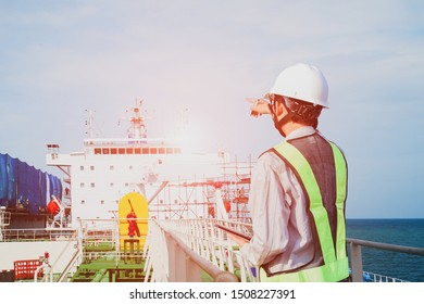 engineer worker on ship deck, on boat during ship repair in floating dry dock on accommodation navigation bridge deck background in shipyard