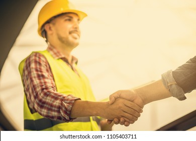 Engineer worker shaking hand with customer or co worker in the office. Focus on the hand.