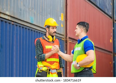 Engineer and worker soul brother handshake, thumb clasp handshake or homie handshake with blurred containers cargo background, Success and Teamwork concept
