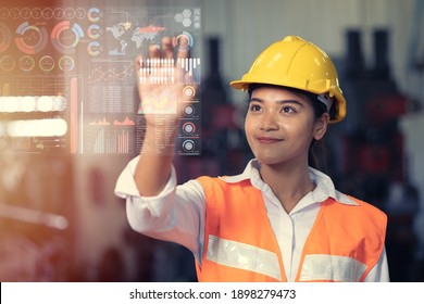Engineer worker using advance technology digital hologram infographics touch panel in industry factory.