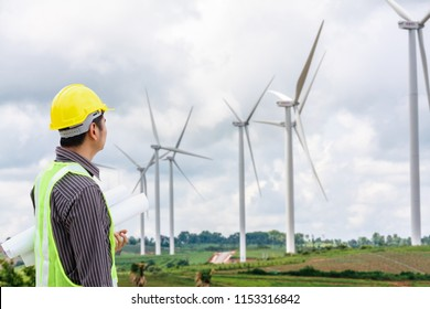Engineer worker at wind turbine power station construction site