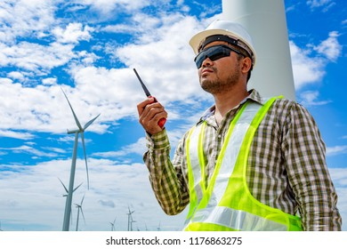 Engineer worker at wind turbine power station construction site.