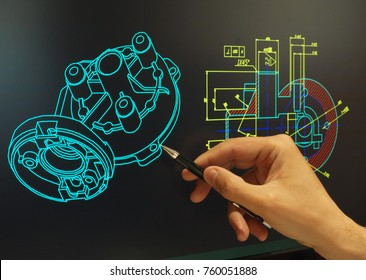 engineer working at computer on mechanical piece design