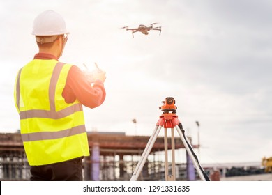 Engineer  working at construction Site with Drone over construction site.