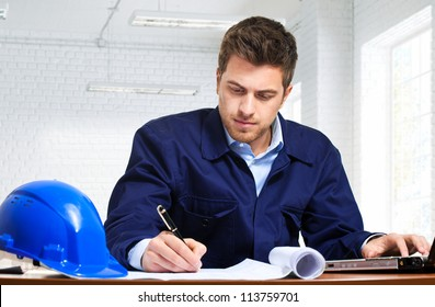 Engineer working at his desk