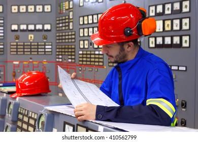 Engineer working in the industrial interior.