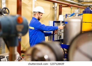 engineer working inside oil and gas refinery. Worker services maintenance oil compressor pump