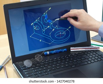 engineer working at laptop computer on cad mechanical piece design