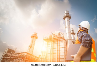 Engineer working and laptop at power plant