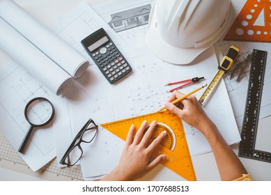 engineer working in office with blueprints, inspection in workplace for architectural plan, construction project ,Business construction