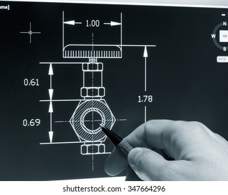 engineer working on a cad blueprint monochrome image