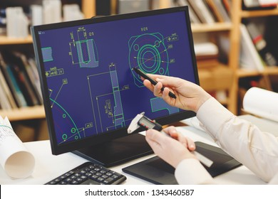 Engineer working on cad scheme using computer tools.