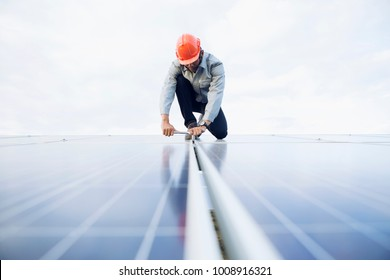 engineer working on checking and maintenance equipment at industry solar power.
