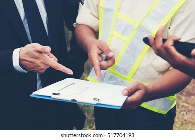engineer working on checking and maintenance equipment at industry solar power; two engineer and technician discussion plan to find problem of solar panel and
