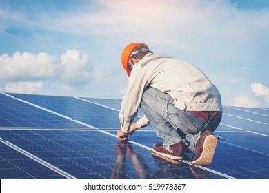 engineer working on checking and maintenance equipment at solar power plant: working on Wrench tightening solar mounting structure of solar panel
