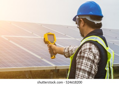 an engineer working on checking and maintenance equipment in solar power plant