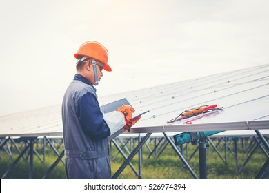 engineer working on checking and maintenance equipment at green energy solar power plant : Checking solar mounting structure
