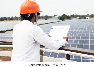 engineer working on checking and maintenance equipment at industry solar power;  engineer discussion plan to find problem of solar panel