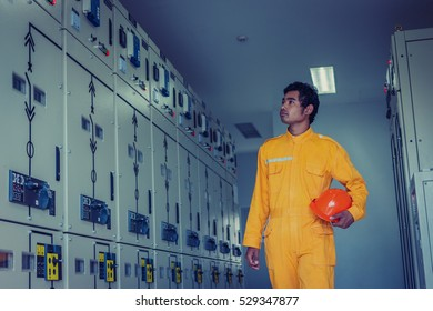 engineer working on checking and maintenance equipment at green energy solar power plant: checking status switchgear