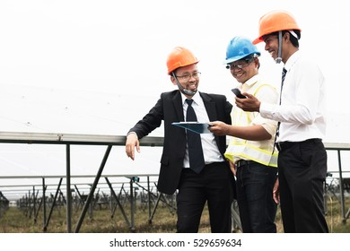 engineer working on checking and maintenance equipment at industry solar power; two engineer and technician discussion plan to find problem of solar panel