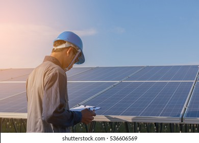 engineer working on checking and maintenance equipment at green energy solar power plant: checking PV structure and PV panel