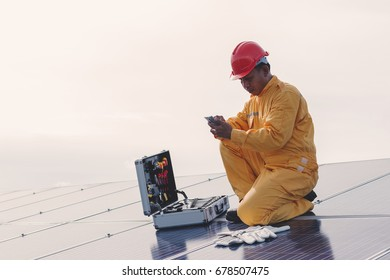 engineer working on checking and maintenance equipment at green energy solar power plant