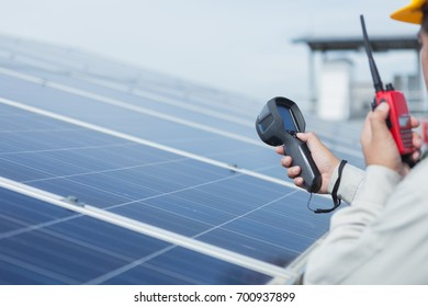 engineer working on checking and maintenance electrical equipment ; engineer inspector working on examining electrical system of solar power plant