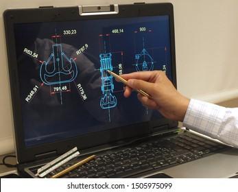 engineer working on computer at crane hook design