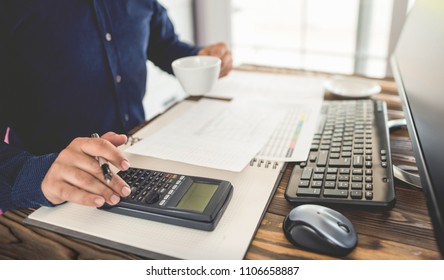 Engineer Working on Computer and Making Calculations in Office Room