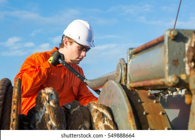 Engineer is working on the deck of oil tanker.