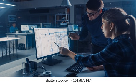 Engineer Working on Desktop Computer, Screen Showing CAD Software with Technical Blueprints, Her Male Project Manager Explains Job Specifics. Industrial Design Engineering Facility Office