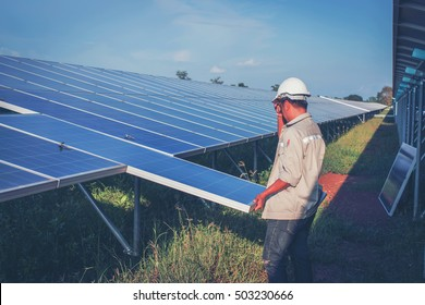 engineer working on  maintenance equipment at green energy solar power plant: working on Wrench tightening at solar mounting structure