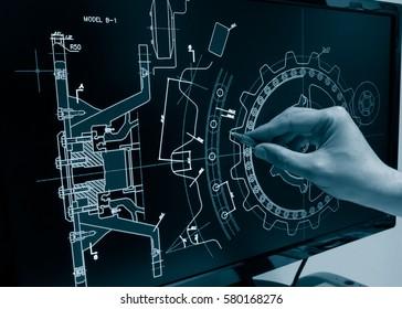 engineer working on mechanich piece computer design