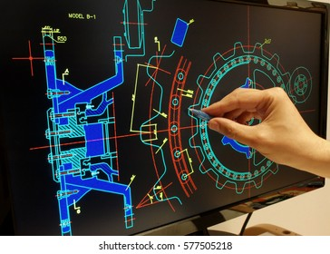 engineer working on mechanichal piece computer design