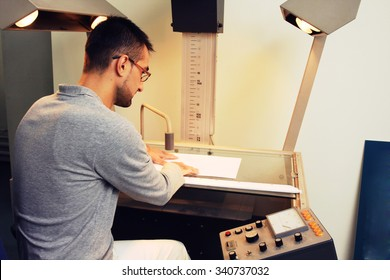 engineer working on a project with microfilm camera.