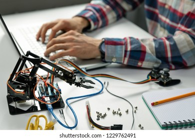 engineer working on robotics automation project