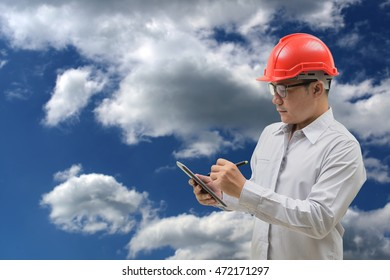 engineer working on sky-clouds background.