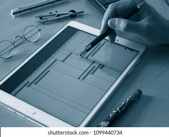 engineer working on tablet computer on chart of project time table progress chart of project monochrome image