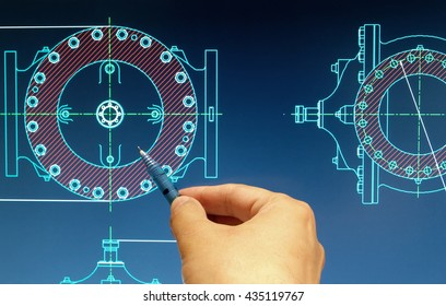 engineer working on valve cad blueprint detail