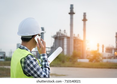 Engineer working in the power plant with talking controlling work.