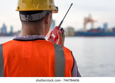 Engineer working radio communication at building construction site