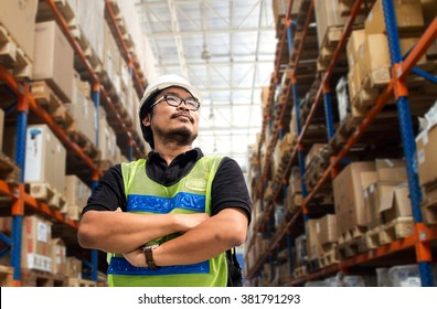 Engineer working and standing in warehouse