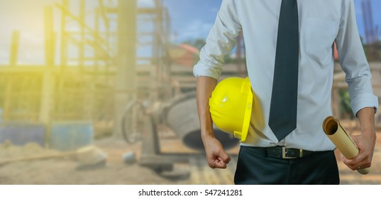 engineer yellow helmet for workers security on the background of a new high-rise apartment buildings