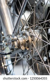 Engineered motorcycle wheel parts. Disc brake suspension and spokes in close-up. Mechanical engineering design and technology image.